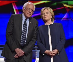 Democratic presidential candidates  Sen. Bernie Sanders, of Vermont, left, and Hillary Rodham Clinton talk before the CNN Democratic presidential debate Tuesday, Oct. 13, 2015, in Las Vegas. (AP Photo/David Becker)