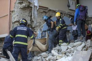 Rescuers of Italian Protezione Civile and firefighters look for missing people on rubble of collapsed building in Amatrice, central Italy, where a 6.1 earthquake struck just after 3:30 a.m., Italy, 24 August 2016. The quake was felt across a broad section of central Italy, including the capital Rome where people in homes in the historic center felt a long swaying followed by aftershocks. ANSA/ MASSIMO PERCOSSI