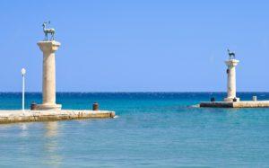 il-colosso-di-rodi-–-una-delle-sette-meraviglie-del-mondo-antico-statues-of-deers-in-harbor-of-rhodes-city-rhodes-island-greece-113-55b0-1